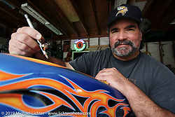 Custom painter Steve Farone working on one of Arlen's creations. CA. 2004. Photograph ©2004 Michael Lichter
