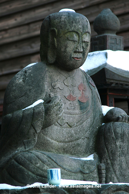 """Jizo in Snow - """"Jizo"""" images and statues are popular in Japan as Bodhisattva who console beings awaiting rebirth and travelers. As such they are often found along roadsides, paths or even street corners."""
