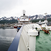 The port and mountains of Ushuaia in southern Argentina from the front deck of the Polar Explorer, and Antarctic ship.