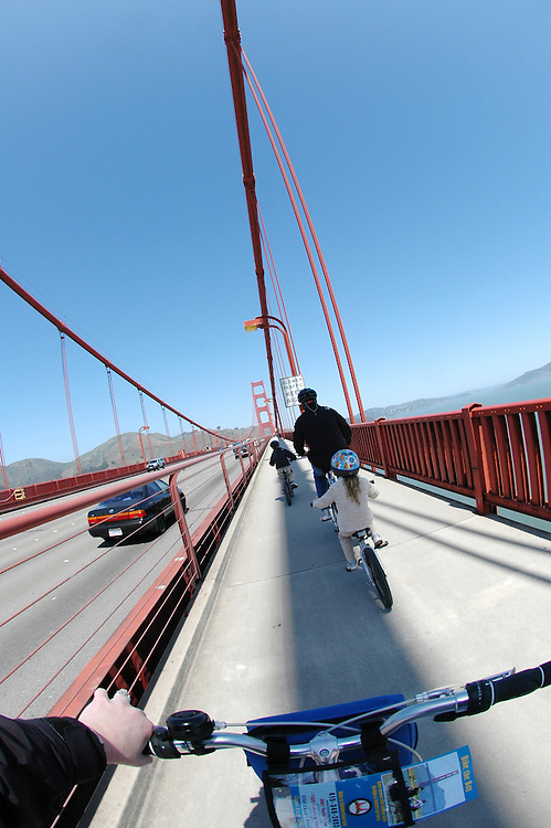 Crossing the Golden Gate bridge on bikes with the kids.  San Francisco, California