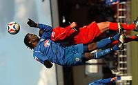 Photo: Ian Hebden.<br />Rushden & Diamonds v Grimsby Town. Coca Cola League 2. 04/03/2006.<br />Grimsby's Gary Cohen (L) beats Rushden's Darren Caskey (L) to the ball.