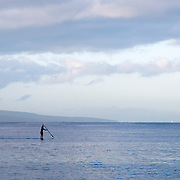 Paddle Surfing at Sunrise in Maui