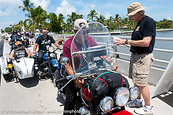 Kerry Patchett on his 1947 Indian Chief coming into the staging area before the finish of the Cross Country Chase motorcycle endurance run from Sault Sainte Marie, MI to Key West, FL. (for vintage bikes from 1930-1948). The staging area on a Key West pier just before the finish and near the end of the 110 mile Stage-10 ride from Miami to Key West, FL USA. Sunday, September 15, 2019. Photography ©2019 Michael Lichter.