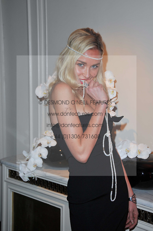 NOELLE RENO at Quintessentially's 10th birthday party held at The Savoy Hotel, London on 13th December 2010.
