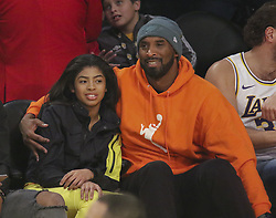 January 26, 2020, Calabasas, California, USA: Basketball legend KOBE BRYANT has died when his private helicopter crashed. He was travelling with at least 3 other people when it went down. There were no survivors. He was 41 she was 13. PICTURED:  Former Laker and NBA great Kobe Bryant attends the game with his daughter Ginna as the host Los Angeles Lakers defeat the visiting Dallas Mavericks 108-95 on Sunday, December 29, 2019, at the Staples Center in Los Angeles, California. (Credit Image: © Burt Harris/Prensa Internacional via ZUMA Wire)