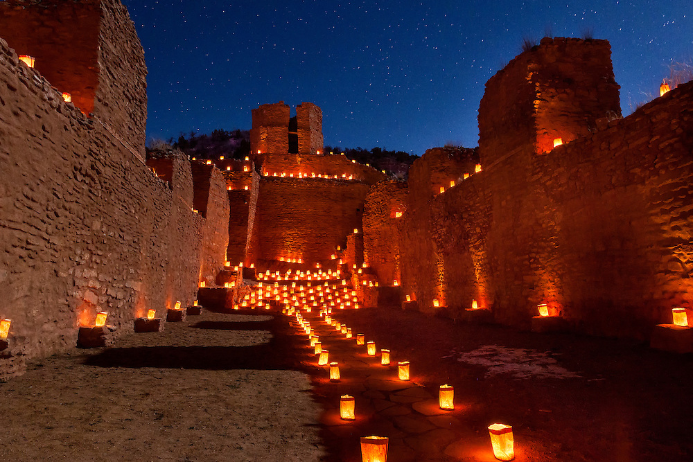Traditional farolitas (or luminarias) adorn the ruins of San Jose de los Jemez Mission Church near Jemez Springs, NM