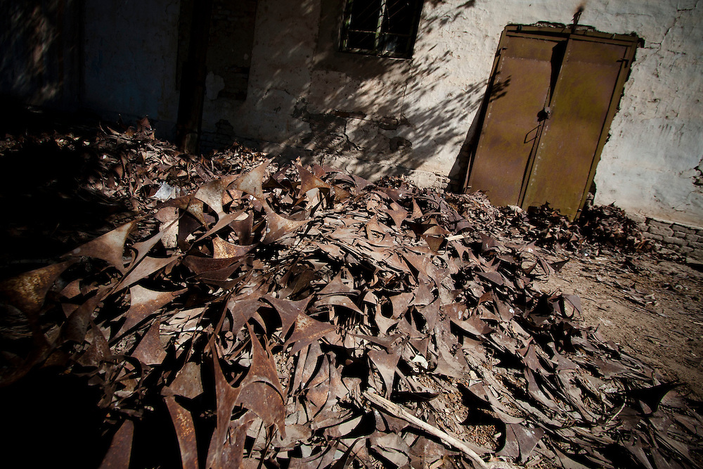 Parts of rusty canned fish remain inside devastated fish processing factory in Moynak, Uzbekistan. Begging from 1984, the Aral Sea has lost its industrial importance.