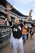 CHICAGO - JULY 23:  Mark Buehrle #56 of the Chicago White Sox waves to the crowd after recording the 18th perfect game in major league history against the Tampa Bay Rays on June 23, 2009 at U.S. Cellular Field in Chicago, Illinois.  The White Sox defeated the Rays 5-0.  (Photo by Ron Vesely)