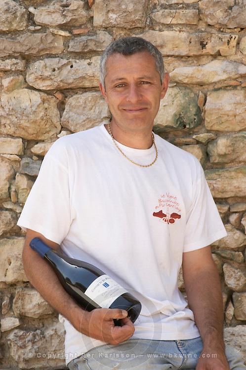 Pierre Ravaille with a magnum bottle of Cuvee Sainte Agnes. Domaine Ermitage du Pic St Loup, Chateau Ste Agnes. Pic St Loup. Languedoc. Owner winemaker. France. Europe. Bottle.