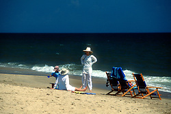 Unidentified bathers loll by water's edge at the Henlopen Acres Beach Club, Monday, Aug. 19, 2019, in Rehoboth Beach, Del. (Photo by D. Ross Cameron)