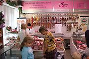 Women making a selection in Polish meat market on Lutomierska Street Balucki District Lodz Central Poland