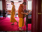 07 APRIL 2013 - CHIANG MAI, CHIANG MAI, THAILAND:  Novices do clean up work in the prayer hall at Wat Jetlin in Chiang Mai, Thailand. Chiang Mai is the largest town in northern Thailand and is popular with tourists and backpackers.       PHOTO BY JACK KURTZ