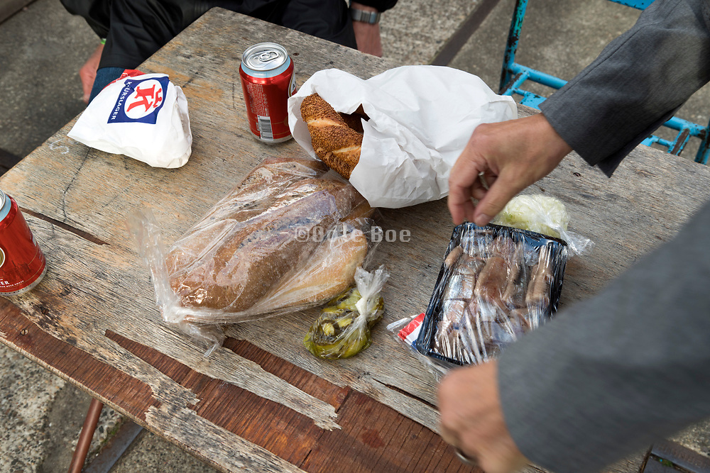 improvised lunch with bread coca cola and fresh raw herring