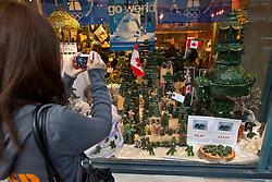 Inuksuks in store windows around Vancouver