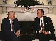 Mikhail S. Gorbachev and President H.W. Bush (Bush 41) talk in the Oval Office at  the Washington summit in May 1990..Photograph by Dennis Brack bb24