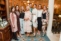 Left to right, Martina, Lady Violet Manners, Cassie Snelgar, Megan Hess, Sabrina Percy, Amber Le Bon, Daisy Knatchbull and Lady Kitty Spencer at an afternoon tea in honour of Megan Hess hosted by Lady Violet Manners at The Lanesborough, Hyde Park Corner, London, England. 10 November 2017.