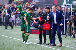 November 4, 2018 - Portland, OR, U.S. - PORTLAND, OR - NOVEMBER 04: Portland Timbers head coach celebrates Jeremy Ebobisse's goal while Sebastián Blanco and Jorge Vilafaña use the opportunity to get a drink of water during the Portland Timbers first leg of the MLS Western Conference Semifinals against the Seattle Sounders on November 04, 2018, at Providence Park in Portland, OR. (Photo by Diego Diaz/Icon Sportswire) (Credit Image: © Diego Diaz/Icon SMI via ZUMA Press)