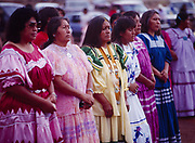 Carla Goseyun's Godmother, Phoebe Cromwell, with women at Carla's White Mountain Apache Traditional Sunrise Ceremony, Whiteriver, Arizona.  Please Note: A small extra licensing fee needs to be paid to the Goseyun Family for usage of this photo. Contact Fred Hirschmann for more information. Thanks.