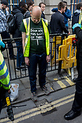 An environmental activist is arrested under Section 14 of the Public Order Act after blocking the highway at Bank in the City of London on the 11th and final day of protests, road-blockages and arrests across London by the climate change campaign Extinction Rebellion, on 25th April 2019, in London, England.