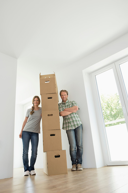 Man woman pile stack boxes new home