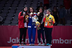 JAKARTA, Aug 24,2018  Khan Jessa (2nd L) of Cambodia, Mahra Alhinaai (1st L) of the UAE, MargaritaOchoa (2nd R) of the Philippines and Duong Thi Thanh Minh of Vietnam pose for photos during the awarding ceremony of Ju-Jitsu Newaza Women's -49 kg competition of the 18th Asian Games in Jakarta, Indonesia, Aug. 24, 2018. Khan Jessa won the gold medal, Mahra Alhinaai won the silver, MargaritaOchoa and Duong Thi Thanh Minh won the bronze. (Credit Image: © Zhu Wei/Xinhua via ZUMA Wire)