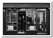 Black and White portrait of Bristol barber James Turnor. James has recently opened his first shop - The Conservatory - in North St, Bedminster, Bristol. This natural light portrait was taken by Jonathan Bowcott who is also based in Bristol.