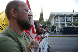 August 17, 2017 - Athens, Greece - KEERFA (Movement against Racism And Fascist Threat) activists demonstrate in fron of the American Embassy in Athens is support of Heather Heyer that lost her life during classes in Charlottesville Usa. Demonstrators shouted slogans against KKK, white supermascists and neonazis. (Credit Image: © George Panagakis/Pacific Press via ZUMA Wire)