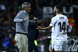 February 28, 2019 - Valencia, Spain - Head coach   of Real Betis Balompie Quique Setien (L) and Jose Luis Gaya of Valencia CF . During Spanish King La Copa match between  Valencia cf vs Real Betis Balompie Second leg  at Mestalla Stadium on February 28, 2019. (Photo by Jose Miguel Fernandez/NurPhoto) (Credit Image: © Jose Miguel Fernandez/NurPhoto via ZUMA Press)