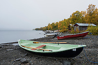 Boats on rocky shore of lake Stor-Tjulträsket, Ammarnäs, Lapland, Sweden