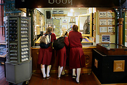 IRELAND DUBLIN 6FEB06 - Schoolgirls dressed in uniforms peek into a stall in Georges Street Arcade.. . jre/Photo by Jiri Rezac. . © Jiri Rezac 2006. . Contact: +44 (0) 7050 110 417. Mobile:  +44 (0) 7801 337 683. Office:  +44 (0) 20 8968 9635. . Email:   jiri@jirirezac.com. Web:    www.jirirezac.com. . © All images Jiri Rezac 2006 - All rights reserved.