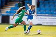 Ashlee Brown of Coventry Utd Ladies and Veatriki Sarris of Birmingham City Women battles for possession during the Women's FA Cup match between Birmingham City Women and Coventry United Ladies at Solihull Moors FC, Solihull, United Kingdom on 18 April 2021.