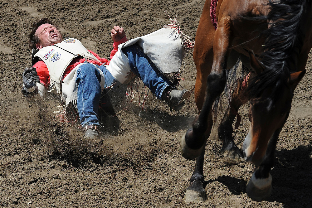 Chris Harris of Itasca, Texas is bucked off of Big Easy during the bareback bronc riding finals on Sunday of the 100th annual California Rodeo Salinas in 2011.