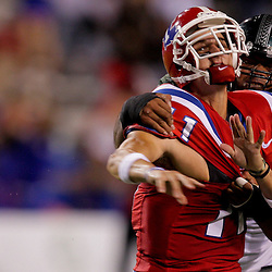 Sep 30, 2009; Ruston, LA, USA; Hawaii Warriors offensive lineman Joey Lipp (58) hits Louisiana Tech Bulldogs quarterback Ross Jenkins (11) as he throws during the second half at Joe Aillet Stadium. Louisiana Tech defeated Hawaii 27-6. Mandatory Credit: Derick E. Hingle-US PRESSWIRE