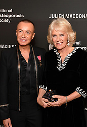 Julien Macdonald and the Duchess of Cornwall at the Julien Macdonald Fashion Show Reception at Lancaster House in London, which is supporting the National Osteoporosis Society charity.