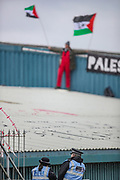 """Tamworth, United Kingdom, May 25, 2021:  Palestine action activists stand on the rooftop as they occupied an Israeli owned weapons manufacturer building in Tamworth, Amington Industrial Estate near Birmingham on Tuesday, May 25, 2021. """"Shut Elbit Down"""", """"Free! Free! Palestine"""" are among the slogans activists shouted whilst on the rooftop of the building, meanwhile police have surrounded the building and intends to arrest them. (Photo by Vudi Xhymshiti)"""