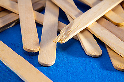 Tongue depressors or frozen treat sticks in abstract positions on a blue background