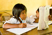 15 MARCH 2006 - CHONG KOH, KANDAL, CAMBODIA: A student does her Khmer reading lesson at the elementary school in Chong Koh, a small village on the Mekong River in central Cambodia. Photo by Jack Kurtz / ZUMA Press