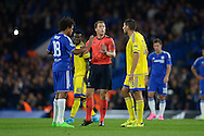Match Referee Felix Zwayer of Germany tries to calm down a situation with Loic Remy of Chelsea and Eitan Tibi of Maccabi Tel Aviv. UEFA Champions League group G match, Chelsea v Maccabi Tel Aviv at Stamford Bridge in London on Wednesday 16th September 2015.<br /> pic by John Patrick Fletcher, Andrew Orchard sports photography.