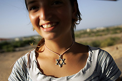 Tilza Matzu, 16, a student, waits for an armored school bus to take her home from the Newe Deqalim settlement, Gaza, Palestinian Territories, Nov. 6, 2004. This particular settlement gets mortared regularly. Israel's parliament recently supported compensation payments for Jewish settlers leaving the Gaza Strip, in a vital vote for Prime Minister Ariel Sharon's plan to evacuate the occupied territory.