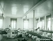 Children's ward in  a hospital where nuns act as nurses. France circa 1905