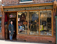 """Oswestry independent shop keepers with """"Keep our town special"""" posters. Business marketing photographer, Oswestry, Shropshire for websites and social media"""