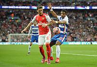 Arsenal's Mesut Özil battles with Reading's Garath McCleary<br /> <br /> Photographer Ian Cook/CameraSport<br /> <br /> Football - The FA Cup Semi-Final - Reading v Arsenal - Saturday 18th April 2015 - Wembley - London<br /> <br /> © CameraSport - 43 Linden Ave. Countesthorpe. Leicester. England. LE8 5PG - Tel: +44 (0) 116 277 4147 - admin@camerasport.com - www.camerasport.com