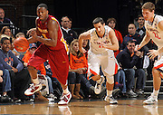 Dec. 30, 2010; Charlottesville, VA, USA; Iowa State Cyclones forward Melvin Ejim (3) steals the ball in front of Virginia Cavaliers guard Sammy Zeglinski (13) and Virginia Cavaliers forward Will Sherrill (22)  during the game at the John Paul Jones Arena. Mandatory Credit: Andrew Shurtleff