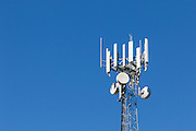 Antennas for 3 sector cellular  communications  mobile telephone system on a triangular lattice tower in Queensland, Australia. <br />