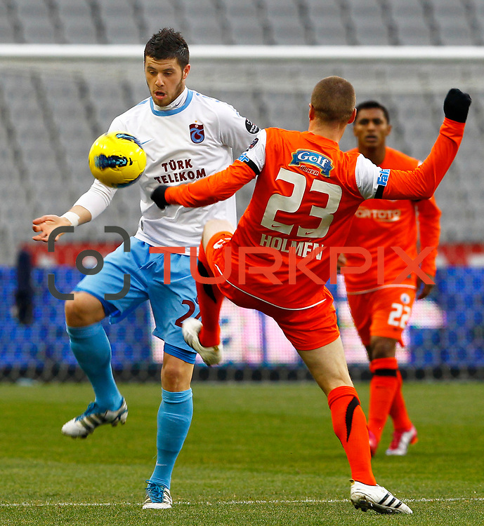 Trabzonspor's Aykut Akgun (L) during their Turkish soccer superleague match IBBSpor between Trabzonspor at the Ataturk Olympic stadium in Istanbul Turkey on Saturday 07 January 2012. Photo by TURKPIX