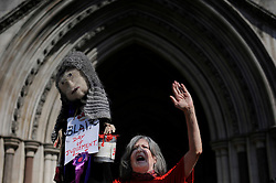 Protesters stands outside The Royal Courts of Justice in London, UK on Monday 28th May  2012..Today former Labour Prime Minister Tony Blair is giving evidence to The Leveson Inquiry into press standards at The High Court. Photo i-Images.