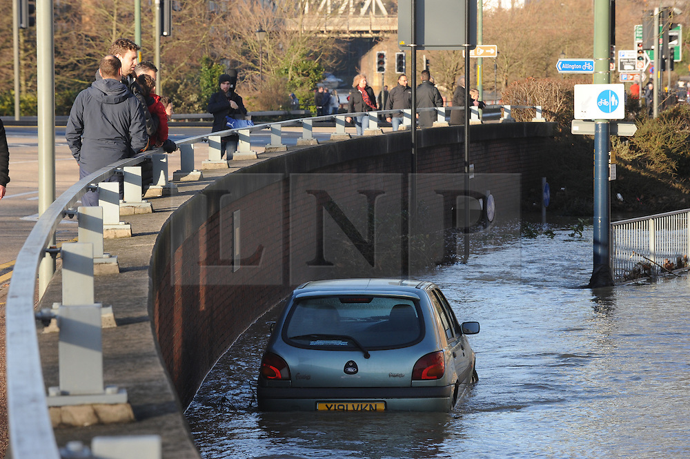 © Licensed to London News Pictures. 26/12/2013<br /> Car abandoned in flood water off the A229 Fairmeadow, Maidstone.<br /> Maidstone Town Centre,Maidstone,Kent is flooded due to the <br />  river Medway Bursting its banks.<br /> Boxing day flooding in Kent.<br /> Large parts of Kent are still flooded due to heavy rain with more bad weather expected.<br /> Photo credit :Grant Falvey/LNP