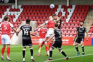 William Boyle (15) of Cheltenham Town and Jordan Tunnicliffe (19) of Crawley Town during the EFL Sky Bet League 2 match between Cheltenham Town and Crawley Town at Jonny Rocks Stadium, Cheltenham, England on 10 October 2020.