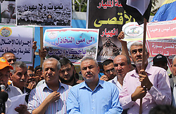 July 19, 2017 - Gaza City, Gaza Strip, Palestinian Territory - Palestinians take part in a protest against the recent closure of the Al-Aqsa Mosque compound by Israel, in Gaza City on July 19, 2017  (Credit Image: © Mohammed Asad/APA Images via ZUMA Wire)