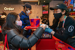 © Licensed to London News Pictures. 20/05/2021. London, UK. Customers order food at the new Jollibee fried chicken flagship restaurant in Leicester Square, West End. Established in 1978, the Filipino fast food company has over 1300 restaurants worldwide. Photo credit: Ray Tang/LNP